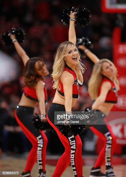 Members of the Chicago Bulls dance team perfom during a break between the Bulls and the Boston Celtics at the United Center on March 5 2018 in...