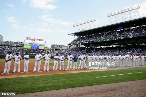 Members of the Chicago Cubs are introduced before game three of the National League Division Series against the Washington Nationals at Wrigley Field...