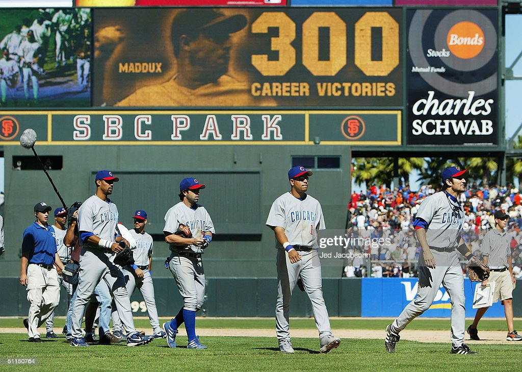 Members of the Chicago cubs leave the field with a sign showing Greg Maddux #31 of the Chicago Cubs after defeating the San Francisco Giants at SBC Park on August 7, 2004 in San Francisco, California. With his victory today, Maddux became the 22nd pitcher to reach 300 career victories.