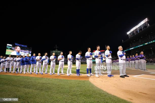 Members of the Chicago Cubs line up for the national anthem before the National League Wild Card game against the Colorado Rockies at Wrigley Field...