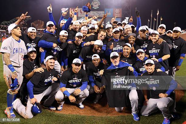 Members of the Chicago Cubs pose for a team photo on the mound after defeating the San Francisco Giants in Game 4 of NLDS at ATT Park on Tuesday...