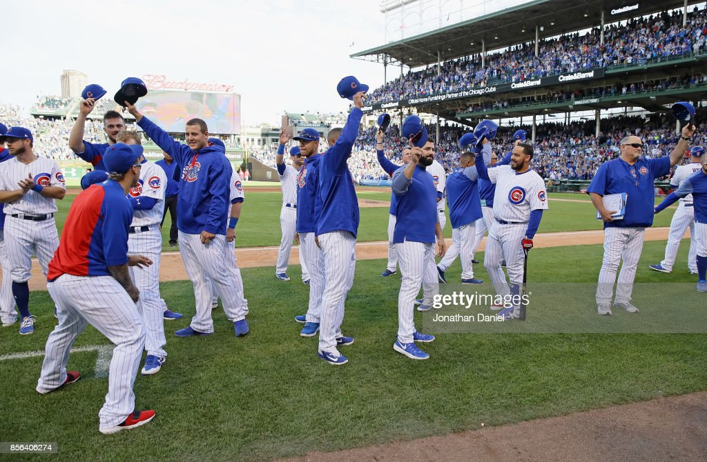 Members of the Chicago Cubs salute the fans after the last regular season game against the Cincinnati Reds at Wrigley Field on October 1, 2017 in Chicago, Illinois. The Reds defeated the Cubs 3-1.