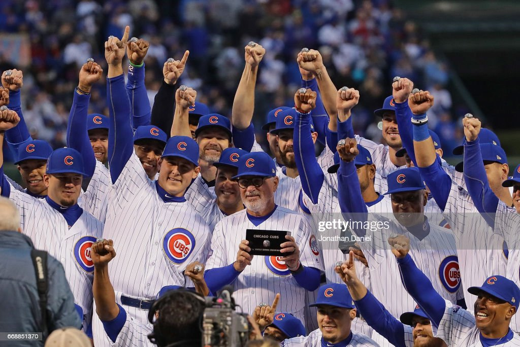 Members of the Chicago Cubs show off their World Series Championship rings before a game against the Los Angeles Dodgers at Wrigley Field on April 12, 2017 in Chicago, Illinois.