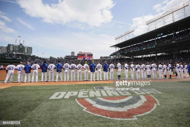 Members of the Chicago Cubs stand during the National Anthem before the Opening Day home game against the Pittsburgh Pirates at Wrigley Field on...