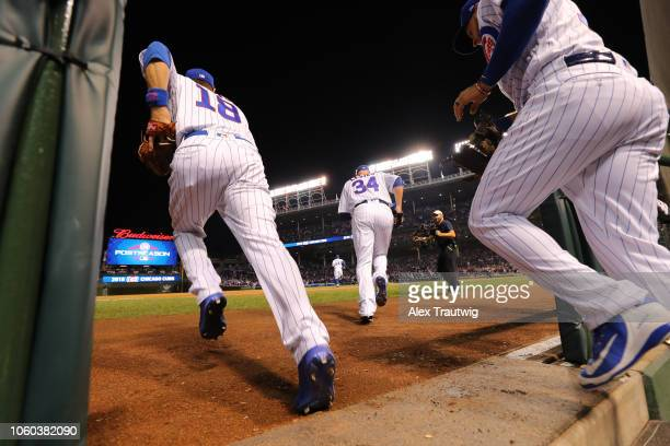 Members of the Chicago Cubs take the field before the National League Wild Card game against the Colorado Rockies at Wrigley Field on Tuesday,...