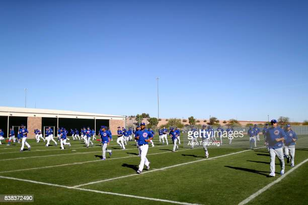 Members of the Chicago Cubs warm up prior to a workout on Saturday February 25 2017 at Sloan Park in Mesa Arizona