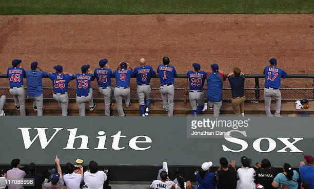 Members of the Chicago Cubs watch from the dugout as their teammates take on the Chicago White Sox at US Cellular Field on June 20 2011 in Chicago...