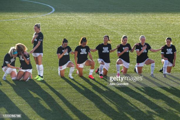 Members of the Chicago Red Stars take a knee during the national anthem before a game against the Washington Spirit in the first round of the NWSL...