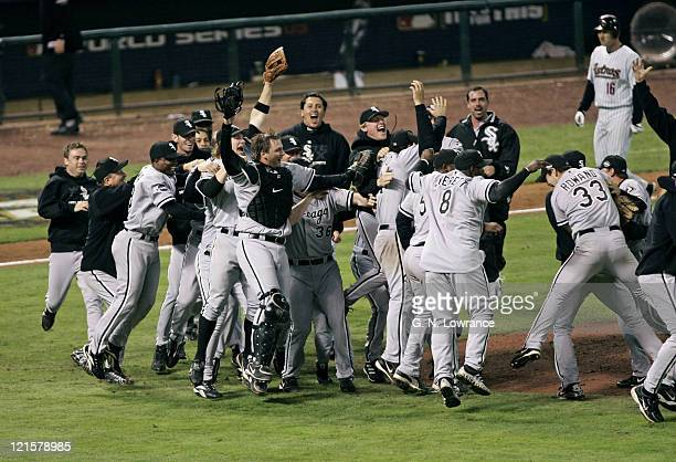 Members of the Chicago White Sox celebrate on the field after winning the 2005 World Series with a 1-0 win over the Houston Astro's at Minute Maid...