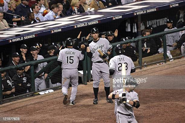 Members of the Chicago White Sox congratulate Tadahito Iguchi and Jermaine Dye during action in game 3 of the World Series between the Chicago White...