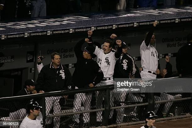 Members of the Chicago White Sox including Aaron Rowand cheer from the dugout during the first inning of Game One of the Major League Baseball World...