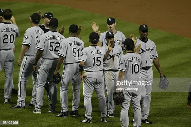 Members of the Chicago White Sox line up after defeating the Cleveland Indians 75 at Jacobs Field on July 16 2005 in Cleveland Ohio Pictured lined up...