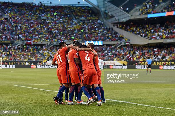 Members of the Chilean team celebrate a goal in the first half during a 2016 Copa America Centenario Semifinal match against Colombia at Soldier...