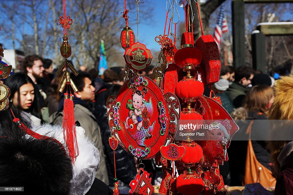 Members of the Chinese American community, tourists and other New Yorkers celebrate the the first day of the Lunar New Year, the Year of the Snake, in New York's Chinatown on February 10, 2013 in New York City. Celebrations are being held in Chinese communities around the world. The lighting of firecrackers are believed to ward off evil spirits and to bring the god of wealth into people's lives once New Year's Day arrives.