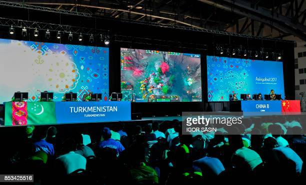 Members of the Chinese and the Turkmen eSports teams compete in the eSports tournament at the Asian Indoor and Martial Arts Games in Turkmenistan's...