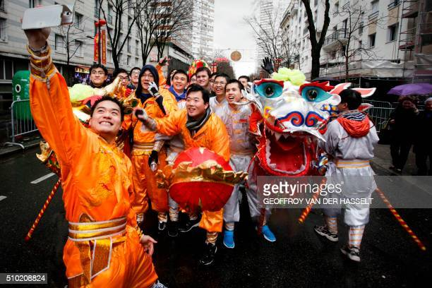 Members of the Chinese community celebrate the Chinese Lunar New Year on February 14 in Paris Millions of Chinese around the world are celebrating...