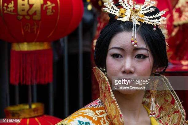 Members of the Chinese community celebrate the 'Chun Jie' also known as Chinese New Year marking the beginning of the Year of the Dog on February 18...