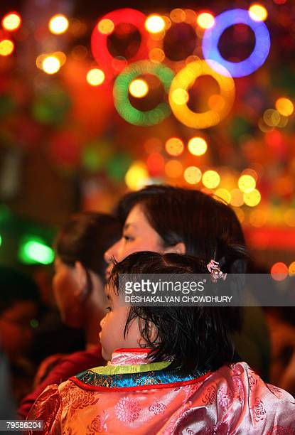 Members of the chinese community in India watch a dragon dance performance as they celebrate the Lunar New Year in China Town Kolkata late on...
