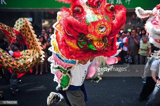 Members of the Chinese community in Peru take part in the celebrations of the Chinese New Year in Lima on January 22 2012 AFP PHOTO/ERNESTO BENAVIDES
