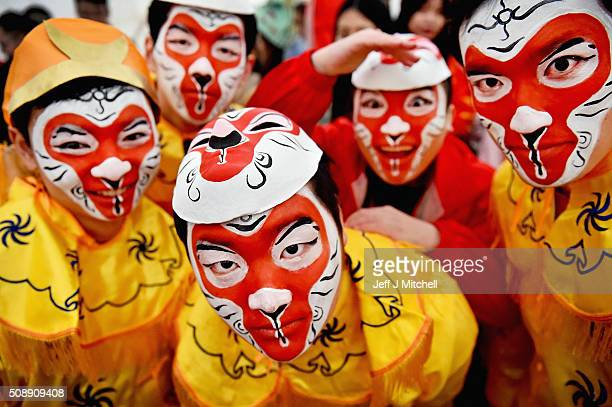 Members of the Chinese community of Glasgow dressed in traditional costumes celebrate The Year of The Monkey on February 7 2016 in Glasgow Scotland...