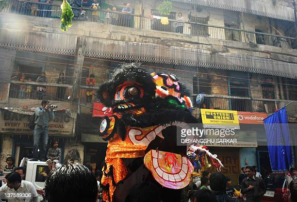 Members of the chinese community perform a dragon dance as they celebrate the Chinese New Year in Kolkata on January 23 2012 China is welcoming the...