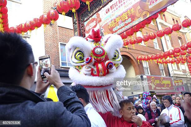 Members of the Chinese community perform a 'lion dance' as they celebrate the Lunar New Year of the Rooster in London UK on January 28 2017 The Lunar...