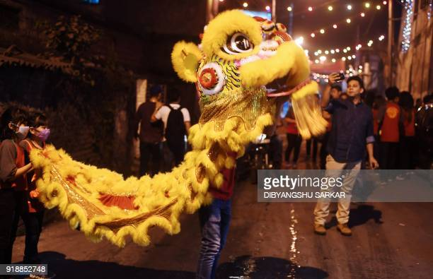 TOPSHOT Members of the Chinese community perform a lion dance as they welcome the Lunar New Year of the dog at the China town area in Kolkata on...