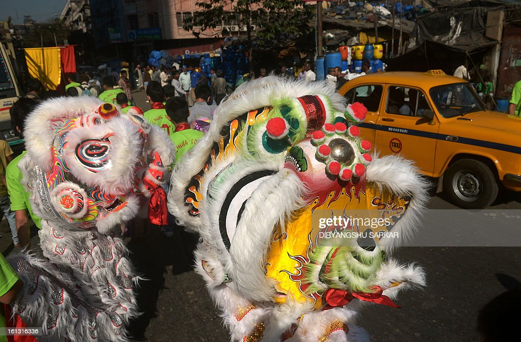 Members of the Chinese community prepare to perform a lion dance as they celebrate the Chinese New Year in Kolkata on February 10, 2013. Chinese communities worldwide are welcoming the 'Year of the Snake'. AFP PHOTO/Dibyangshu SARKAR