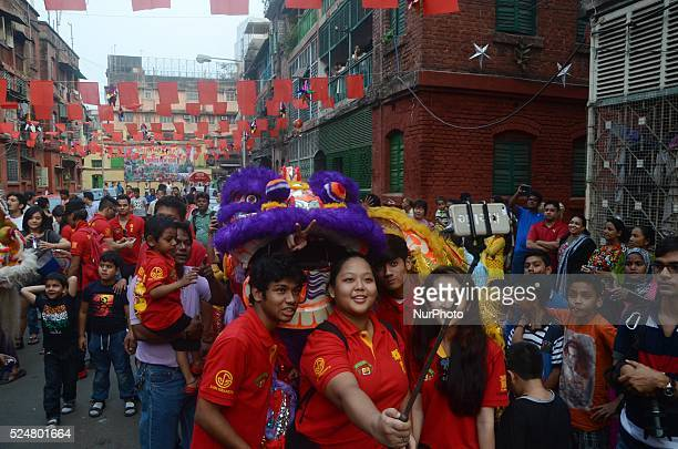 Members of the Chinese community taking selfie with dragon to celebrate the Chinese New year in the streets of Kolkata India on Monday 8th February...