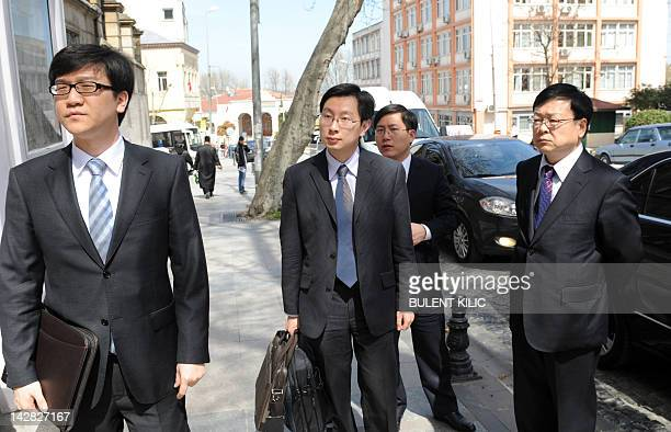 Members of the Chinese delegation arrive at the Consulate of Iran on April 13, 2012 on the eve of the resumption of talks between the European Union...