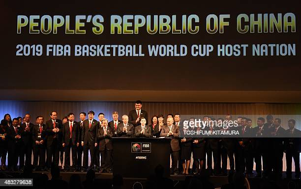 Members of the Chinese delegation celebrate after FIBA president Horacio Muratore from Argentina announced China as the host country of the 2019 FIBA...