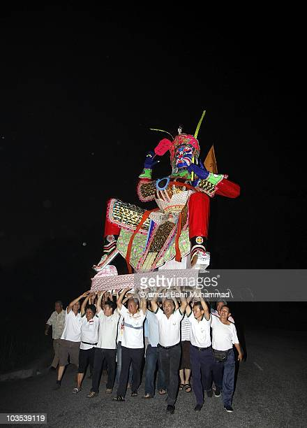 Members of the Chinese ethnic community carry the statue of the Chinese deity Da Shi Ye or Guardian God of Ghosts during the Chinese Hungry Ghost...