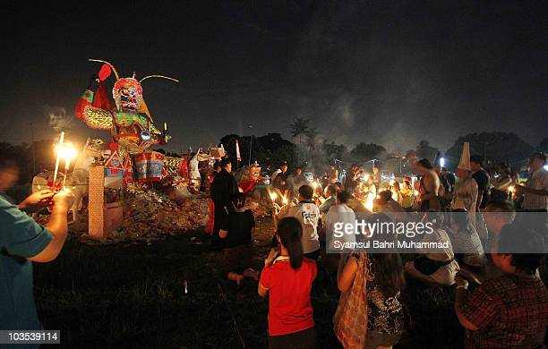 Members of the Chinese ethnic community perform prayers at a statue of the Chinese deity Da Shi Ye or Guardian God of Ghosts during the Chinese...