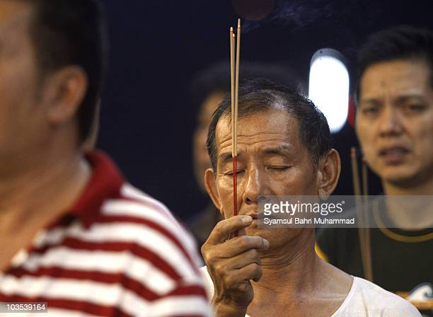 Members of the Chinese ethnic community perform prayers during the Chinese Hungry Ghost Festival on August 22 2010 in Shah Alam Malaysia The Hungry...
