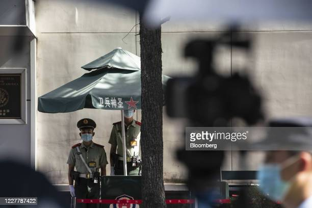 Members of the Chinese People's Armed Police stand in front of the U.S. Consulate General Chengdu in Chengdu, China, on Sunday, July 26, 2020....