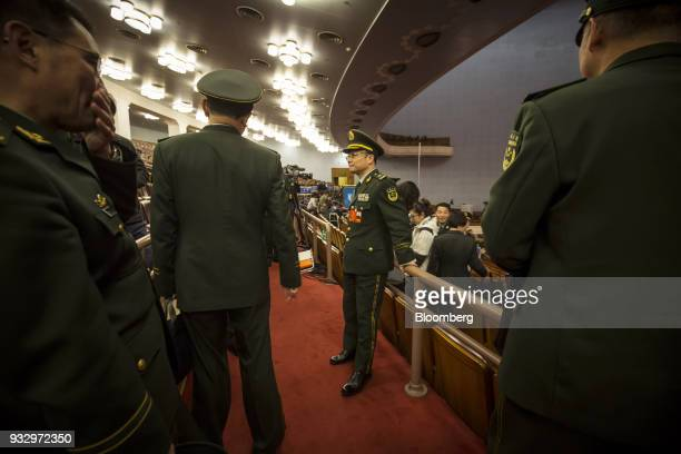 Members of the Chinese People's Liberation Army band stand ahead of a session during the first session of the 13th National People's Congress at the...