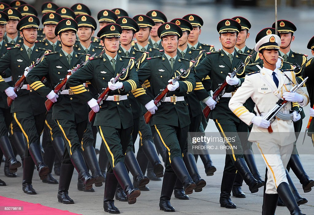 Members of the Chinese People's Liberation Army march ...