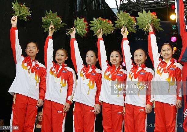 Members of the Chinese team Fei Cheng Yilin Yang Ning He Shanshan Li Sha Xiao and Yuyan Jiang pose with their silver medals on the podium of the...