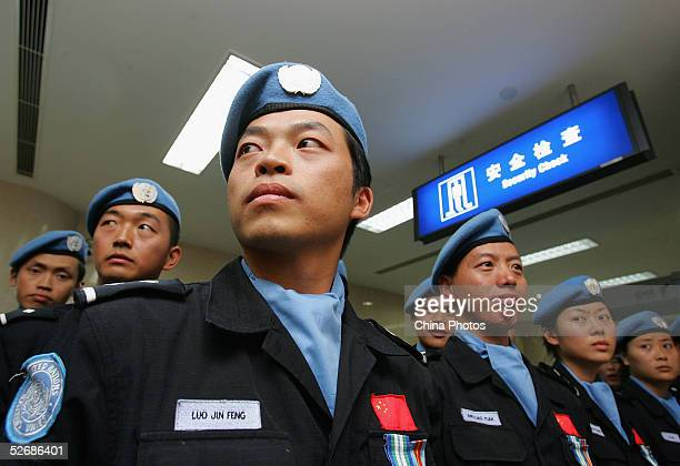 Members of the Chinese UN peacekeeping force from Chongqing arrive at the Chongqing Jiangbei International Airport on April 21, 2005 in Chongqing...
