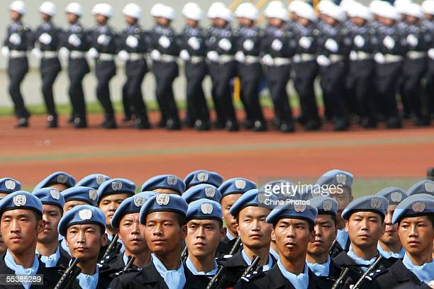 Members of the Chinese UN peacekeeping force from Chongqing march during an anti-terror drill September 12, 2005 in Chongqing Municipality, China....
