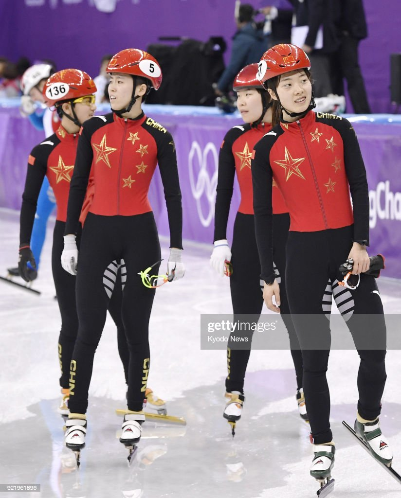 Members of the Chinese women's short track speed skating team react after their disqualification in the 3,000-meter relay finals at the Pyeongchang Winter Olympics in Gangneung, South Korea, on Feb. 20, 2018. ==Kyodo
