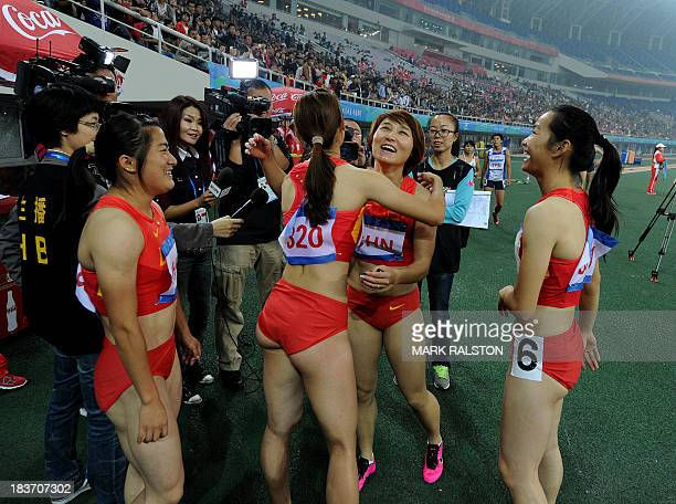 Members of the Chinese Womens team celebrate after winning the 4x100m Relay Final during the East Asian Games held at the Tianjin Olympic Center...