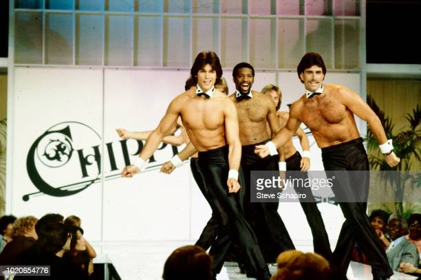 Members of the Chippendales dance group perform on stage for an audience Los Angeles California 1982 The dancers wear collars bowties and shirt cuff...