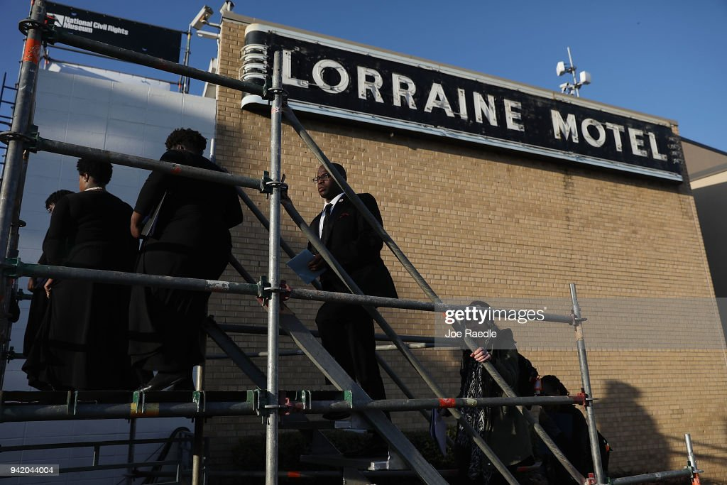 Members of the choir walk on stage at Lorraine Motel, where Dr. Martin Luther King, Jr. was murdered, during a ceremony on the 50th anniversary of his assassination, April 4, 2018 in Memphis, Tennessee. The city is commemorating his legacy with a series of events, including speeches and memorials on the balcony outside his hotel room 306, which is now part of the complex of the National Civil Rights Museum.
