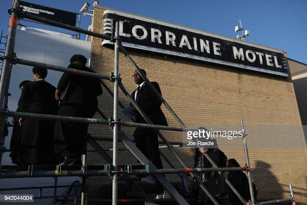 Members of the choir walk on stage at Lorraine Motel where Dr Martin Luther King Jr was murdered during a ceremony on the 50th anniversary of his...