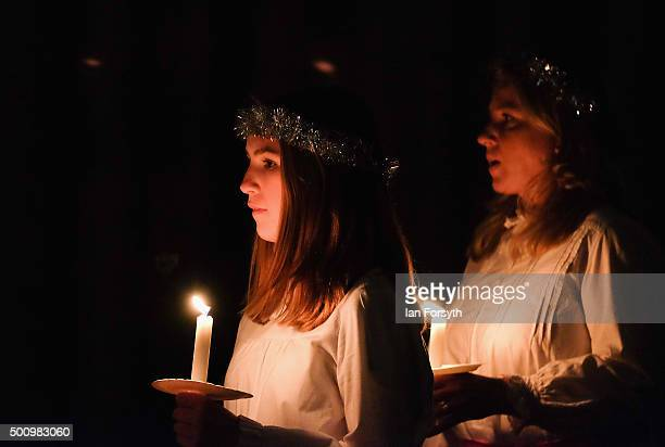 Members of the Chorus Pictor choir sing during the traditional Swedish festival of Sankta Lucia in York Minster on December 11 2015 in York England...