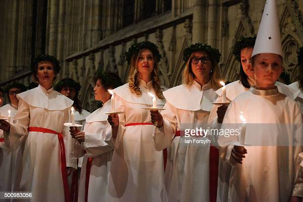 Members of the Chorus Pictor choir wait for the start of the traditional Swedish festival of Sankta Lucia at York Minster on December 11 2015 in York...