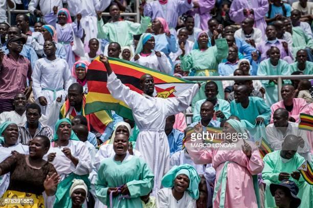 Members of the Christian Church Jowani Masowe Vadzidzi Vajesu celebrates during the newly swornin President Inauguration ceremony at the National...