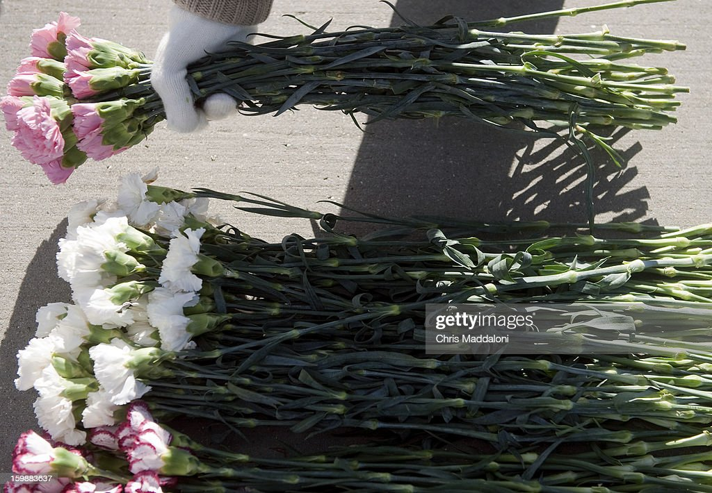 Members of the Christian Defense Coalition protest against abortion in front of the Supreme Court by placing 3300 flowers on the ground, which they said represent 'the number of children aborted everyday.' Today is the 40th anniversary Tuesday of Roe vs. Wade, the landmark U.S. Supreme Court decision that legalized abortion.