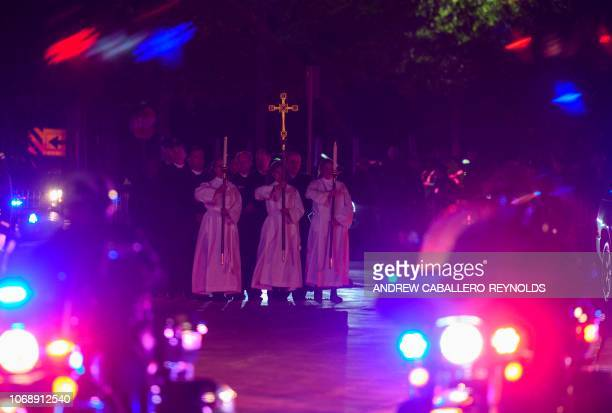 Members of the church and an honor guard wait to receive the casket of former US President George HW Bush before carrying it into the St Martins...